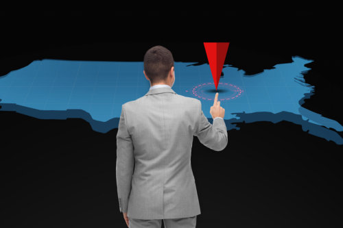 businessman with virtual usa map and pointer
